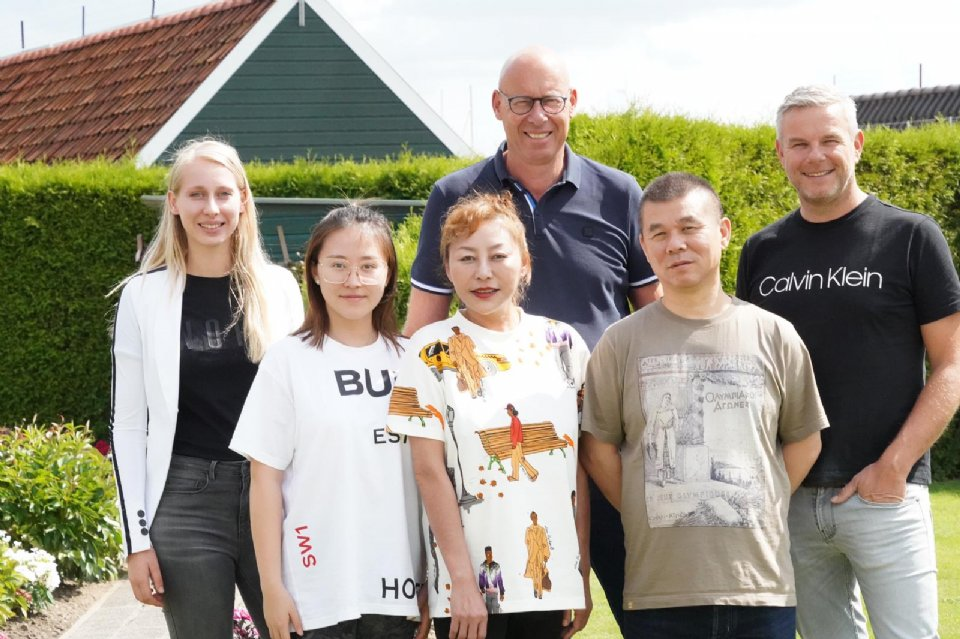 Wang Zhijun with his wife and daughter visiting Eijerkamp